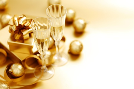 festive occasions: golden christmas background champagne gifts ball Stock Photo