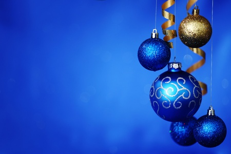 christmas balls on blue satin background photo