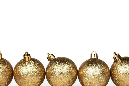 group of christmas baubles: golden christmas ball isolated on white