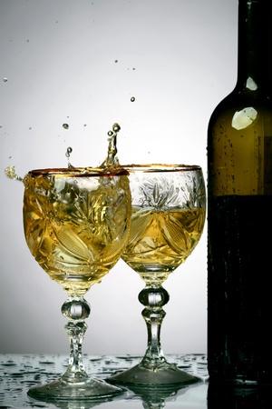 bartend: wine splash on gray  background Stock Photo