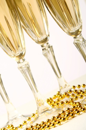 champagne in glasses on white background photo