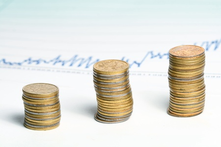 coins and financial graph on background photo