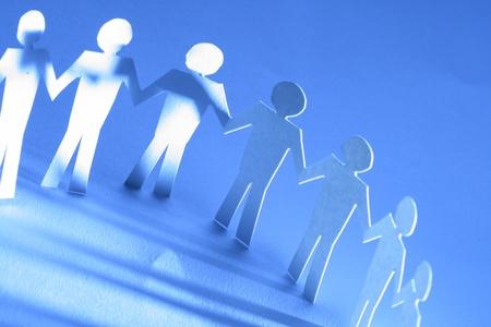 cooperativismo: equipo de papel unidos entre sí concepto de asociación
