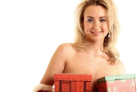 sexy santa girl hide behind gift box photo