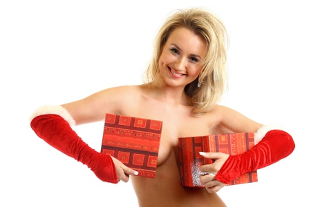 mrs claus: sexy santa girl hide behind gift box Stock Photo