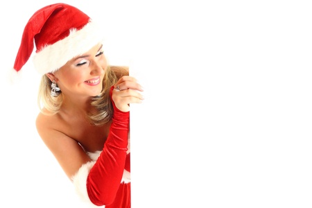 exhibiting: pin-up santa girl hold in hands christmas empty blank
