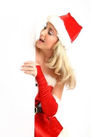 dona: pin-up niña santa en suspenso las manos vacías en blanco navidad