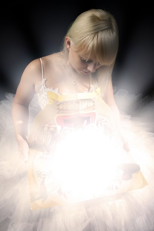 miracles: girl find the super magic in simple open book Stock Photo