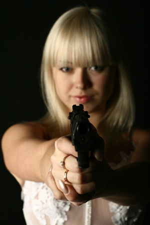 kill: bride in white dress with pistol wants to kill you