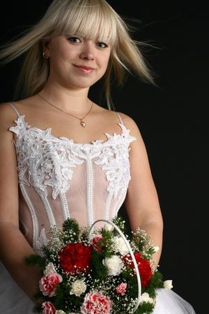 blondie: bride flowers very happy in white dress flowers Stock Photo