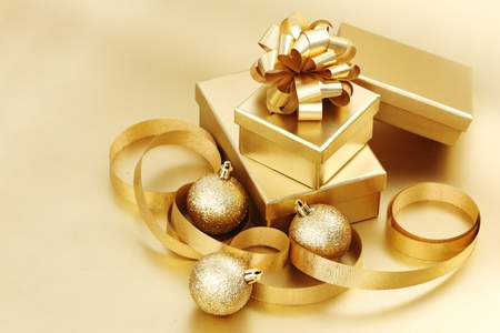 liquid gold: golden christmas background gifts ball