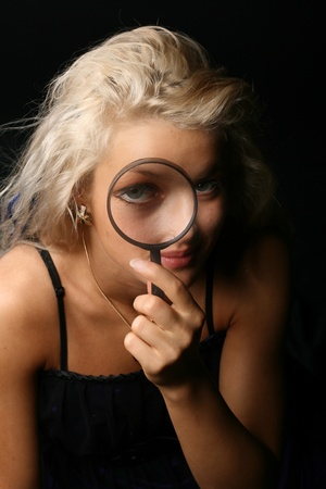 blondie: beautiful blondie girl with magnifier looka at you