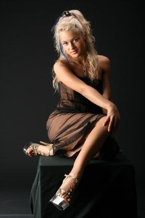 blondie: girl posing on black