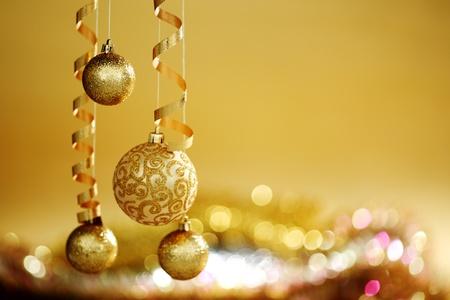 golden christmas balls on bokeh background Stock Photo