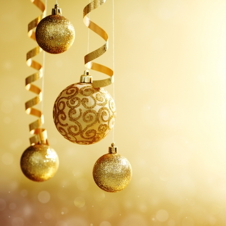 gold christmas: golden christmas balls on bokeh background Stock Photo