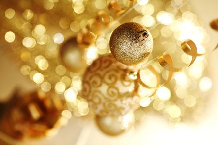 golden christmas balls on bokeh background photo