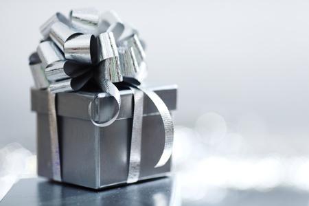 blue gift box: silver christmas gift macro close up