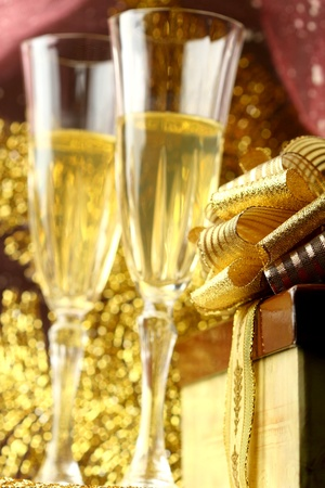holiday card golden champagne and gift photo