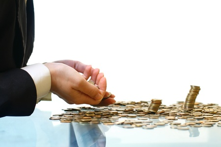 hand make coins piles on white Stock Photo - 11148907