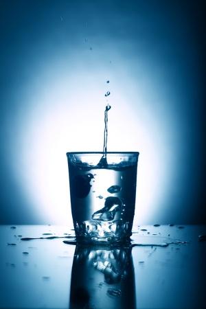 alcohol splash on gray background photo