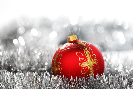 Holiday Decorations: red christmas ball on holiday background