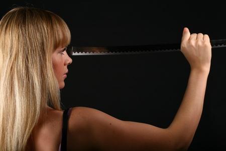 sword girl on black background kill you photo