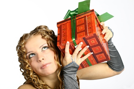 The girl with a gift in cheerfully box smiles new year Stock Photo - 11245828