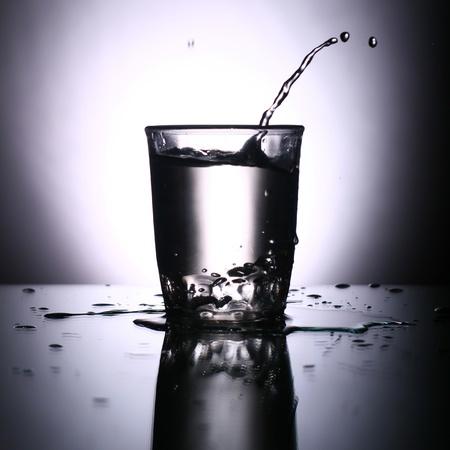 alcohol splash on gray background Stock Photo - 11245763