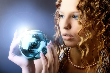 christmas spirit: The girl with a magic New Years sphere is very surprised holidays