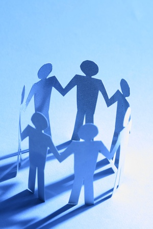 cooperative: paper team linked together partnership concept