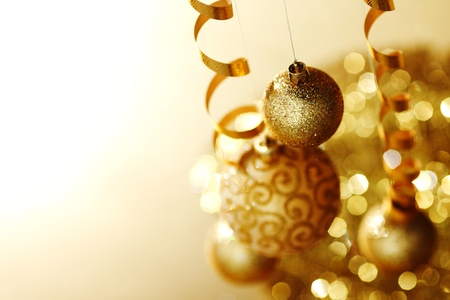 golden christmas balls on bokeh background Stock Photo - 11278595