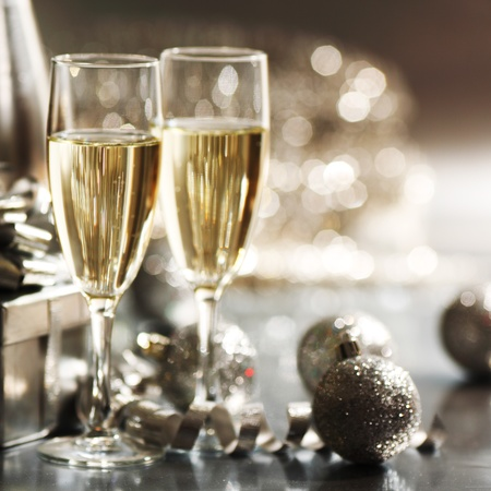 luxury party: golden christmas background champagne gifts ball Stock Photo