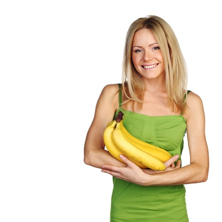 woman holding a bunch of bananas on white background photo