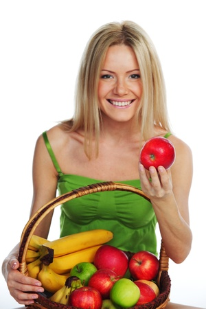 woman holds a basket of fruit on a white background Stock Photo - 11278644