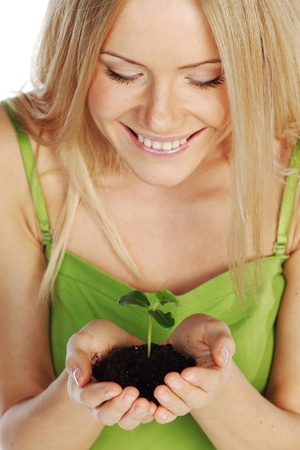 plant in blonde hands close up Stock Photo - 11278681