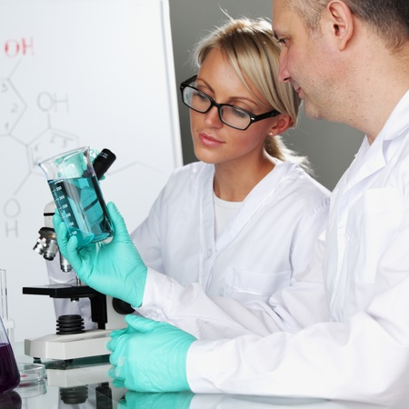 two scientist in chemical lab conducting experiments Stock Photo - 11278621