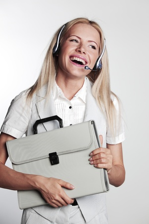 call girl: business woman in a headset on a gray background