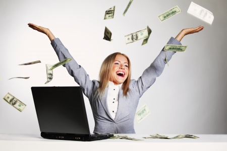 finance girl: business woman drop dollars in the air