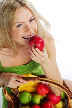 woman holds a basket of fruit on a white background Stock Photo - 11340472