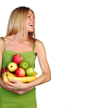 nutrition health: woman holds a pile of fruit on a white background Stock Photo