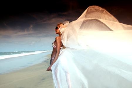 sexy bride: bride vacation on ocean coast Stock Photo