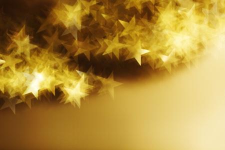 照らす: ゴールデン スター ボケ背景をクローズ アップ