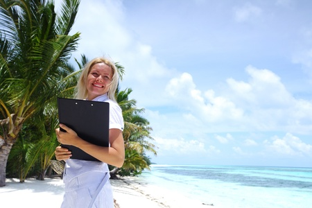 business woman on ocean coast on the background of a palm trees and sky and sea Stock Photo - 11368126