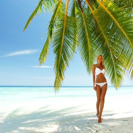 backgroud: woman under palm sea on backgroud