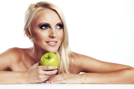 woman eat green apple on white background Stock Photo - 11367896