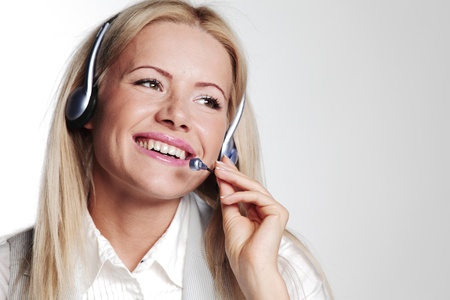 business woman in a headset on a gray background Stock Photo - 11373080