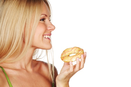 woman eating cake: woman eating a cake on a white background Stock Photo