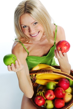 woman holds a basket of fruit on a white background Stock Photo - 11373171