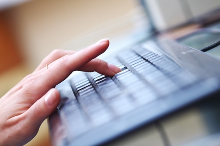 woman hands working on keyboard photo