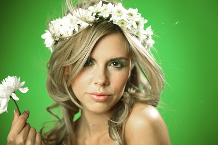 young women on green flowers in hair photo